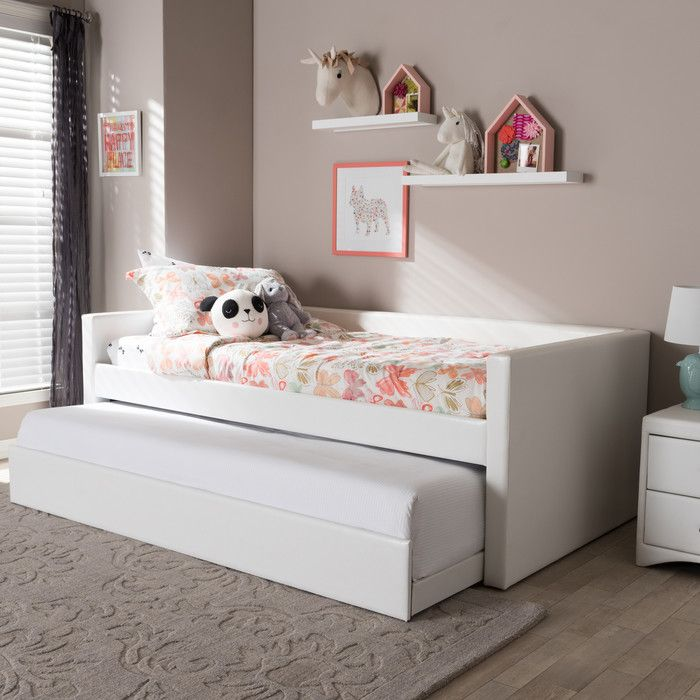 Bring a beautiful and cozy addition to your youth's bedroom with the Alda daybed. Upholstered in a soft and durable faux leather with accent top stitching. Featuring clean lines, the daybed has a trim square profile as well as a pull out trundle unit for extra sleeping space. Included is a sturdy slat system for equal weight distribution and safety.