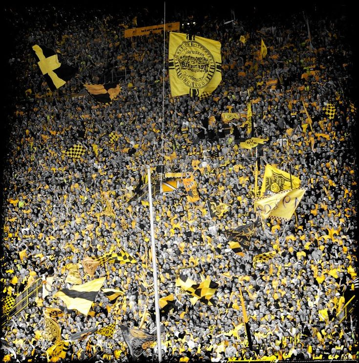 South stand in Dortmund's Signal Iduna Park. Over 22,000 black and yellow supporters watching from the stand how their soccer team is facing the opponents in the German Bundesliga. It's the nearest thing to the Colosseum in Rome you ever come accross.