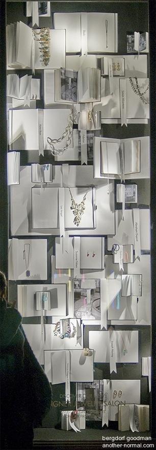 displaying jewelry on books in window