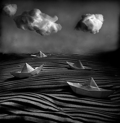 paper boats in black and white