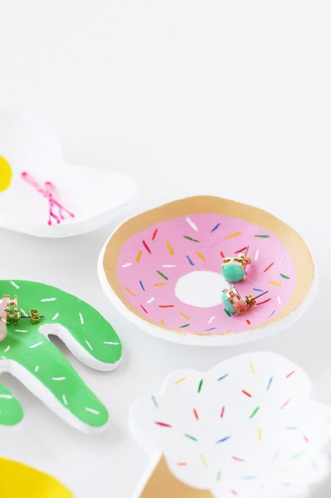 Playfully put your accessories on display with a fun + vibrant donut-themed tray.