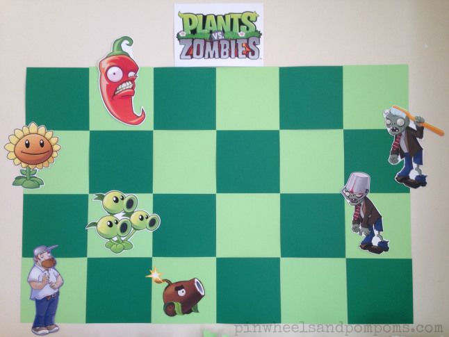 Backdrop above a Plants vs Zombies dessert table. Squares of green card and some character printouts to look like the game!