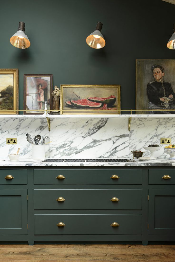 Bold green cabinets, brass knobs with marble countertops. Peckham Rye Kitchen'…