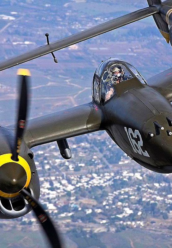 Lockheed P-38 Lightning. My high school chemistry teacher, Mr Williams, flew many missions over Europe in one of these. It was easy to divert him from the periodic table of elements to one of his daring flights in a P-38!