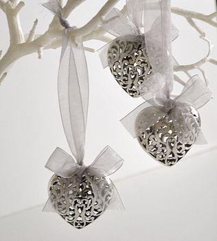 filigree hearts with silver ribbon