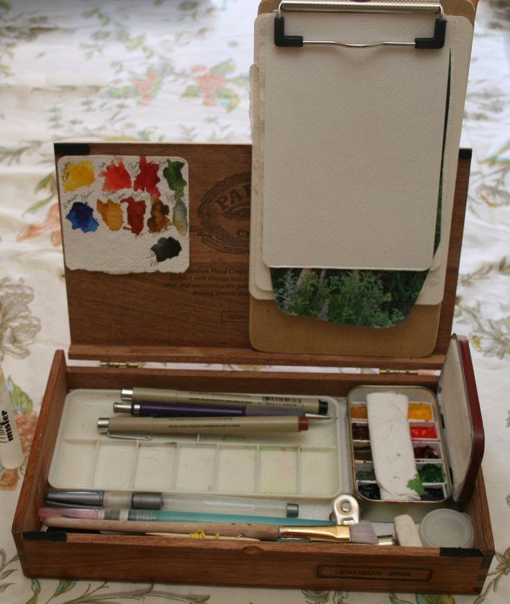 cigar box of art supplies to keep in car
