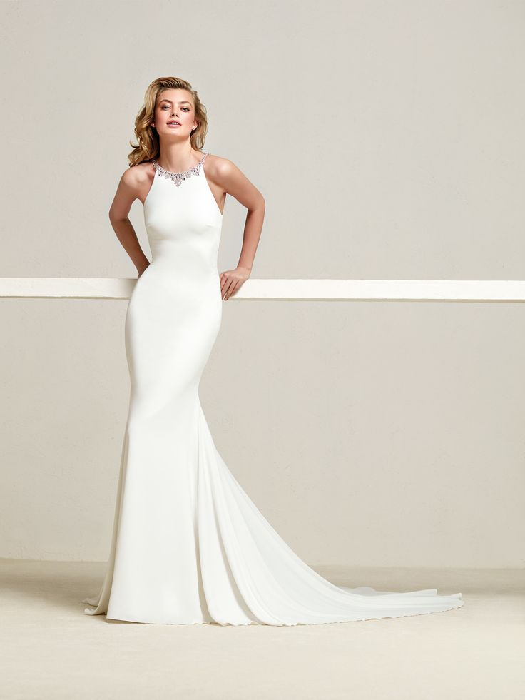Dreba: It will be love at first sight with this mermaid style wedding dress with its spectacular back in crystal tulle and gemstones - Pronovias