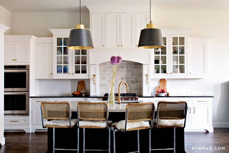 Marcel Breuer counter stools in white kitchen. Simone Howell's North Dallas Home | Rue