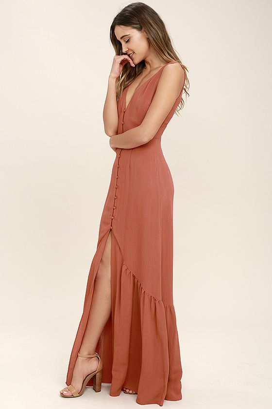We're dreaming of a nice tall glass of lemonade and the Simpatico Rust Orange Maxi Dress! Lightweight gauzy rayon shapes a V-neckline and darted bodice. A covered button placket leads to a set-in waist and ruffled maxi skirt with sexy front slit. Hidden back zipper.