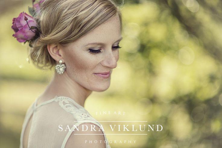Bride portrait, blonde bridal hair with roses, lace wedding dress, eye lashes, diamond earrings