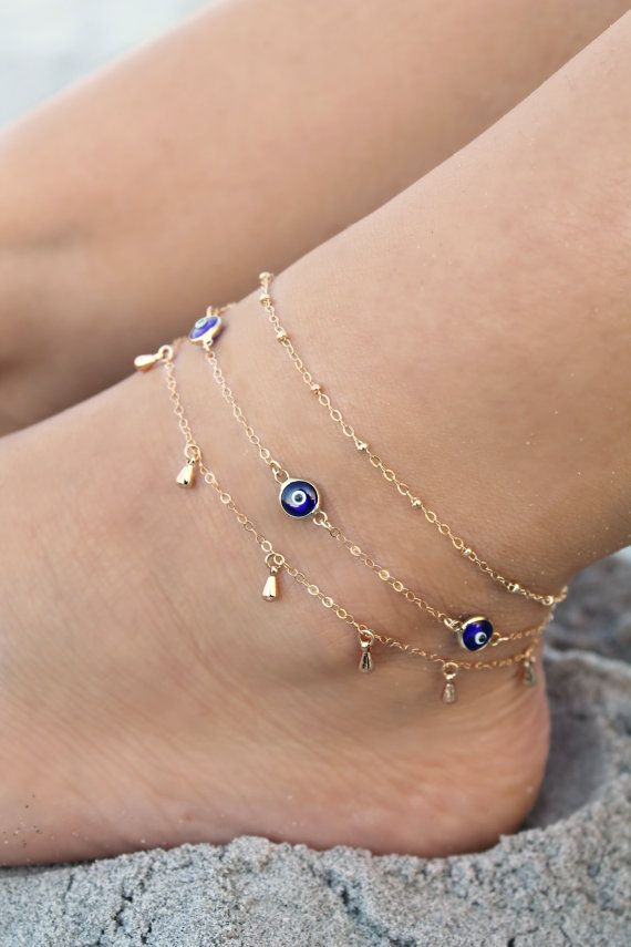 This listing is for one evil eye anklet only (aqua blue or navy blue). Other anklets showing on the model are available separately in my shop. This delicate ankle bracelet is made with little glass evil eye charms in gorgeous aqua blue OR deep navy blue, attached on a shimmering 14k gold filled chain. Wear it on its own or layer with other anklets :) These Evil eye beads represents an ancient talisman that protects from evil eye and brings good luck. Please select length and color (aqua…