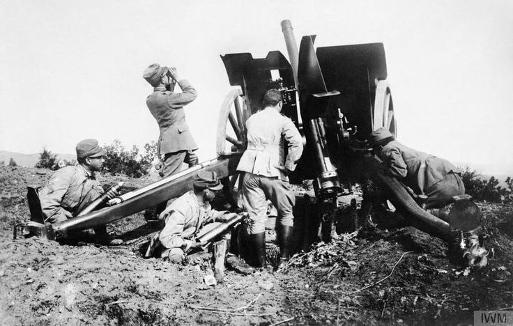 An Italian 75-mm field gun, point upwards so that it can be used as an anti-aircraft gun