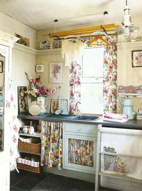 a little cottage kitchen... I love all the fabric & the shelf at the top of the wall.  I want one of these shelves both in my kitchen and in my dining room for displaying all my china.