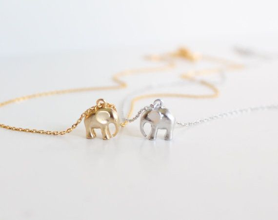 Would be adorable best friend necklaces. | 32 Products Every Elephant Lover Needs In Their Home / insta: janelle317