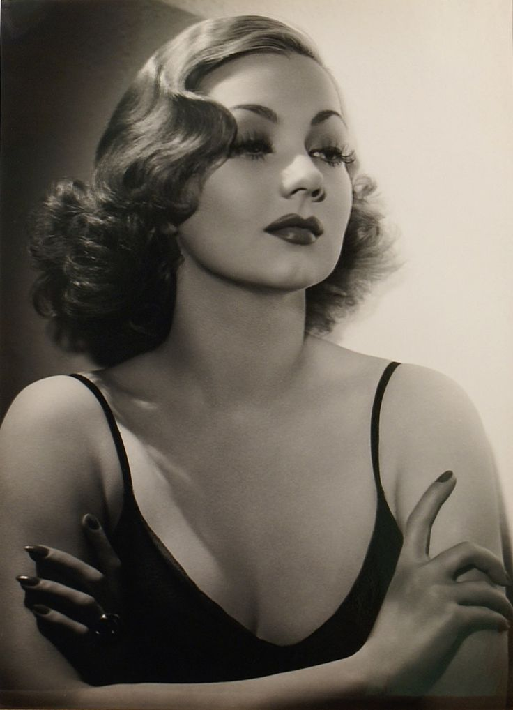 Ann Sothern by Hurrell.  Great example of Hurrell lighting - high spot light for the right side, high fill light for the left half of her face, and a boom light to accent her hair.