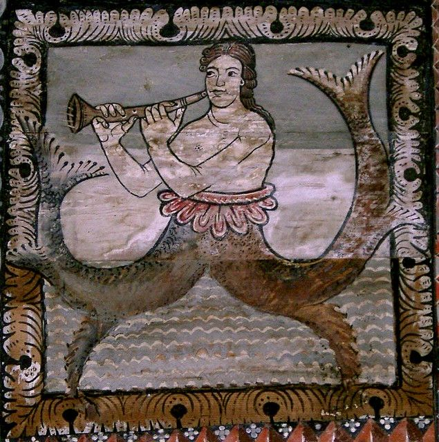 Siren or mermaid playing shalm (flute-like instrument). Painted wooden ceiling from 1109-1114 in the romanesque St. Martin Church, Zillis, Grisons, Switzerland.