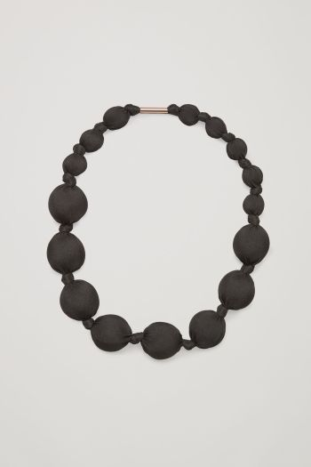 COS image 1 of Mesh covered ball necklace in Black
