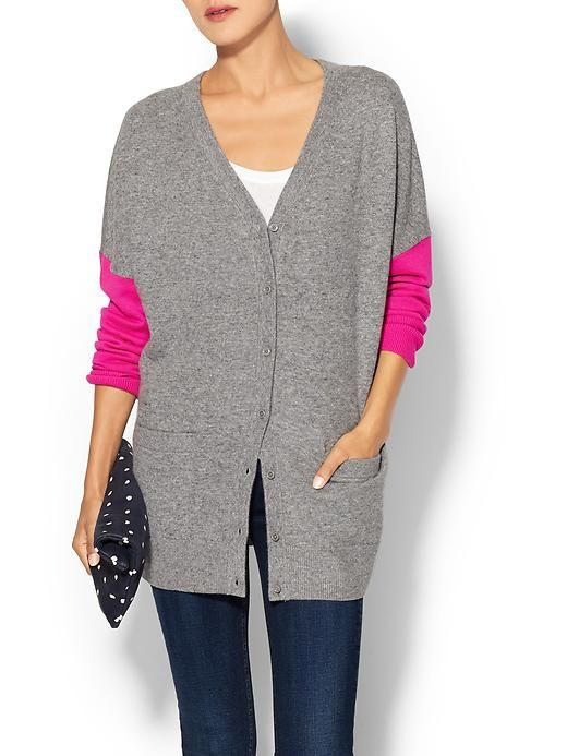 This traditional menswear piece takes on a feminine flirtiness with hot pink color blocked sleeves and a relaxed shape.