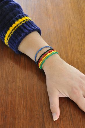 Celebrate the Olympic Games this year with this fun and easy 3rd grade arts and crafts activity: make Olympic ring bracelets using just tape and colored string.