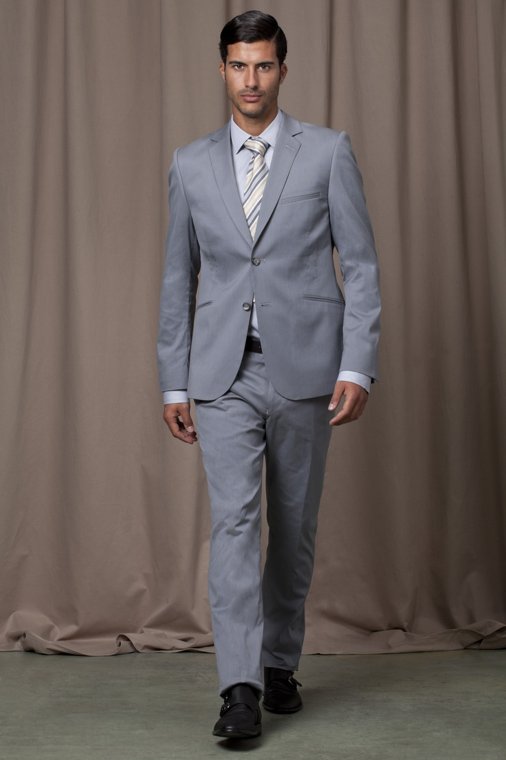 Blue-grey suit, powder blue shirt and white and blue striped tie