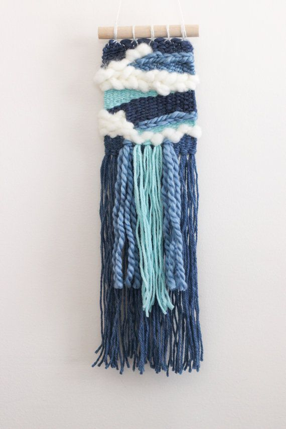 This wall hanging is a one-of-a-kind decoration created to bring life into any space. Each wall hanging is uniquely designed by Brooke Klingsheim,