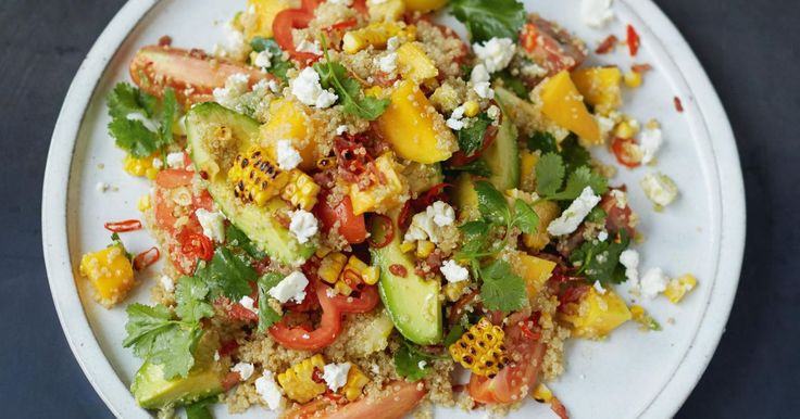 Grilled Corn and Quinoa Salad Mango, Tomatoes, Herbs, Avo, Feta from Jamie Oliver's Everyday Super Food cookbook. This gluten-free recipe is perfect to make ahead for lunch can be easily adapted for vegetarians by foregoing the bacon.