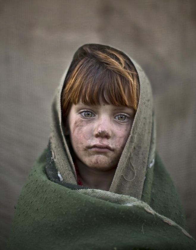 laiba Hazrat, age 6. Candid photos of Afghan refugee children playing in a slum on the outskirts of Islamabad, Pakistan.