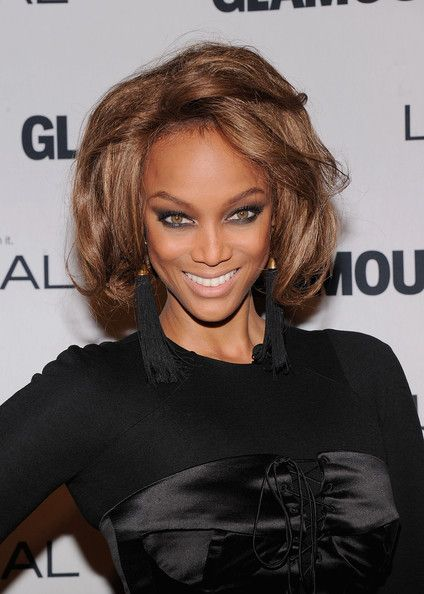 Tyra Banks Hair such a pretty brown, not too dark and not too light.  Easy to add lighter pieces to it and it looks amazing