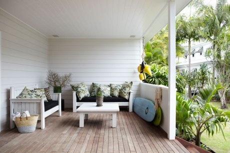 whitewashed furniture and colorful pillows on surfside patio