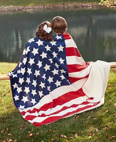 Keep warm and cozy on chilly days with this Jumbo Sherpa-Backed Americana Throw. One side features a large American flag on fleece, while the other side is soli