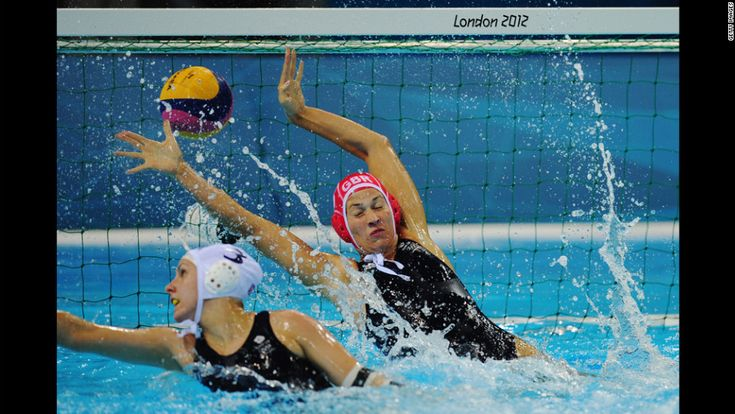 Rosie Morris of Great Britain fails to stop a Russian goal during a women's water polo preliminary match on Monday. - CNN.com