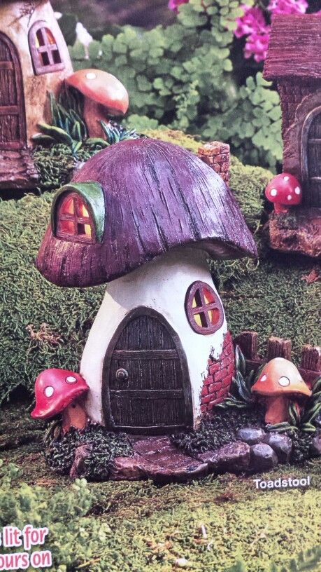 Found this and a few other pictures of fairy garden houses in a lakeside catalog, I'll try to make some out of clay myself!