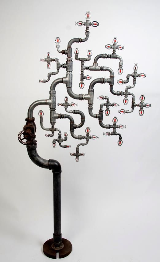 Fire Sprinkler Tree. Photo and sculpture credited to Sam Deal. Sculpture inspired by the Black Saturday fires in Victoria, Australia (February 2009). The sculpture is tree-like in shape and has fire sprinklers for leaves.