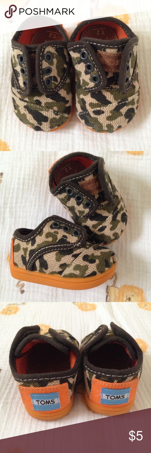 Camo TOMS Shoes (Baby) Fun camo shoes with orange sole detail. EUC. Rarely worn. TOMS Shoes Baby & Walker