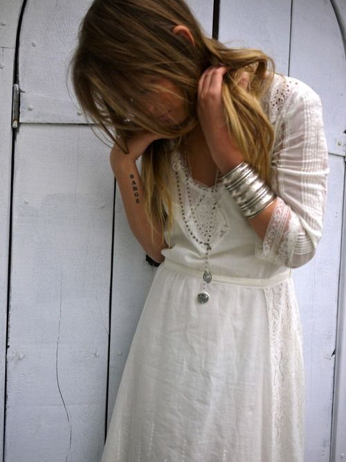 There's something I like about the simple rustic country of this dress with the jewelry/arm hardware