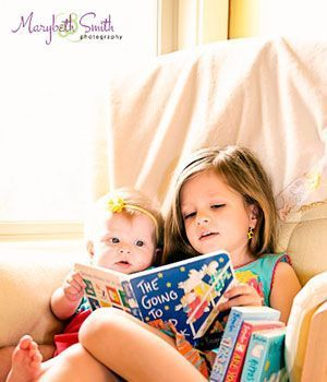 I love it when big sister reads to little sister. Perfect picture for a shared bedroom