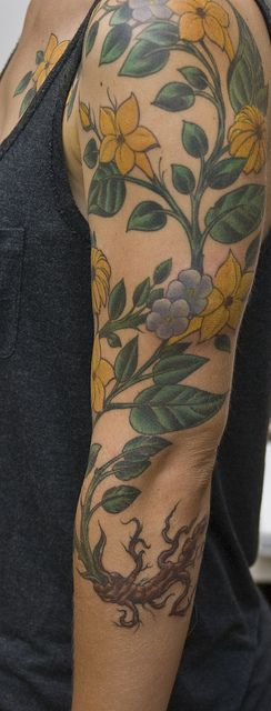 Flower sleeve Would love it more if the leaves were brighter & the flowers were any color but yellow