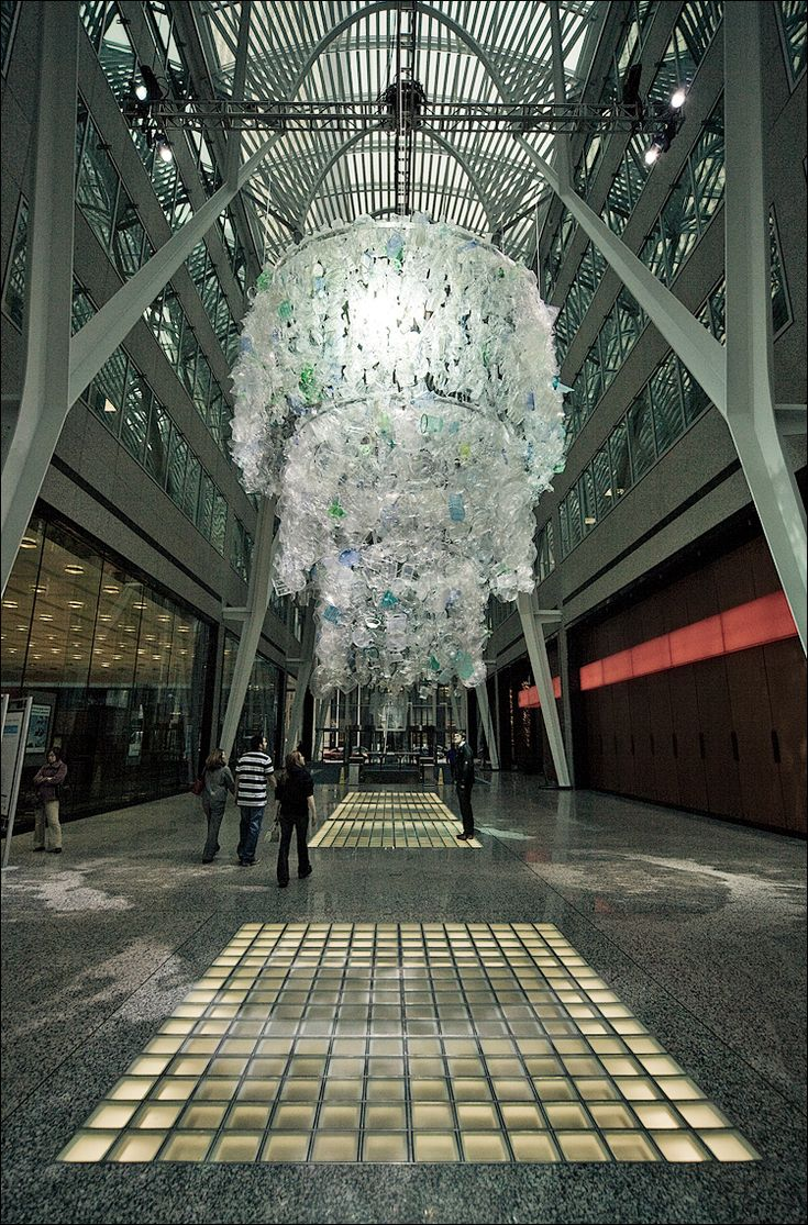 The 25 best plastic chandelier ideas on pinterest decorating eco arts plastic bottle chandelier recycling on a grand scale ecofriend the center for sustainable practice in the arts arubaitofo Images