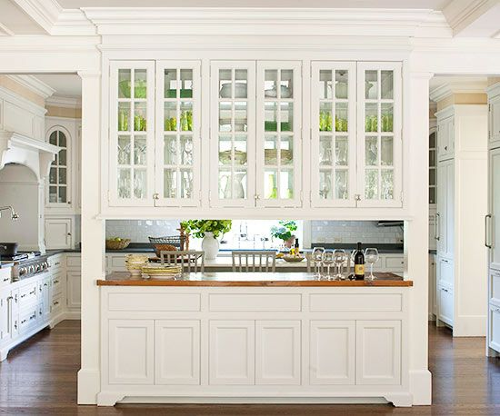 Turn the wall in between a kitchen and dining room into a multipurpose buffet.