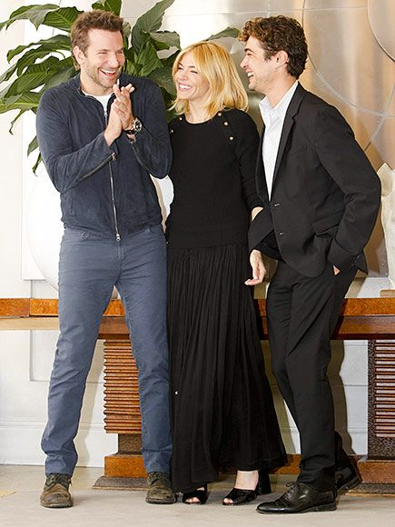 Star Tracks: Thursday, October 29, 2015 | BURNT SIENNA  | Bradley Cooper, Sienna Miller and Riccardo Scamarcio are caught in a candid moment during a photo call for Burnt in Rome on Wednesday.