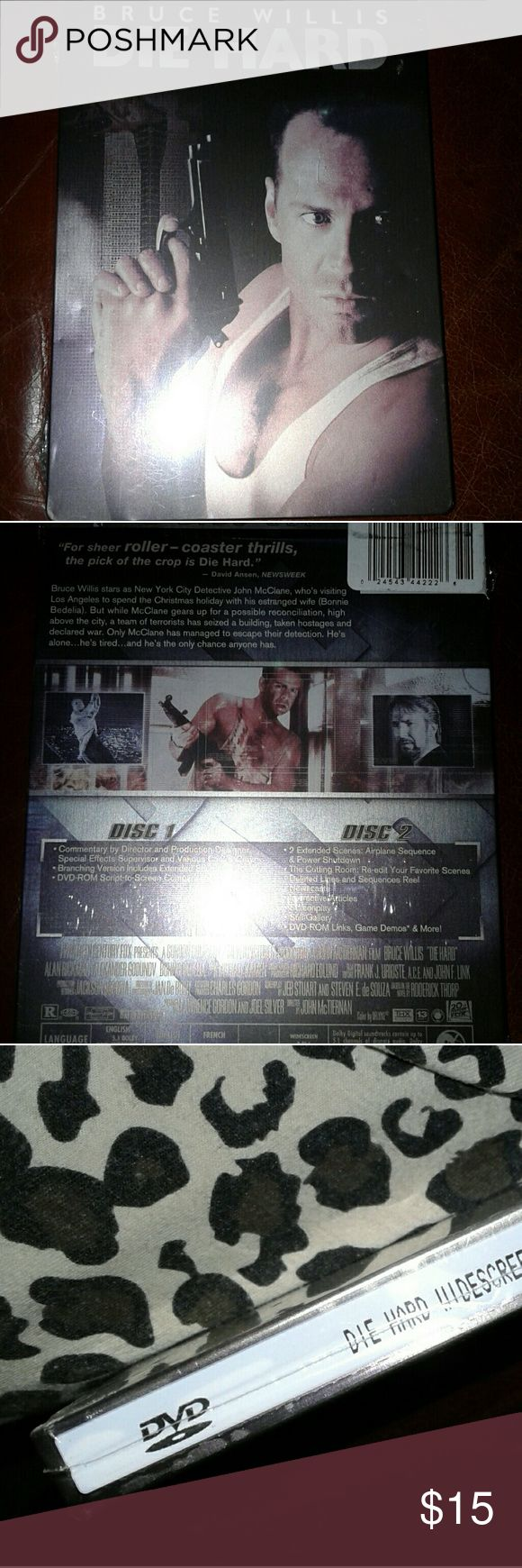 """DIE HARD"" DVD MOVIE TIN BOX UNOPENED ""DIE HARD"" BRUCE WILLIS, 1ST of the series, in a black & white effect covershot TIN BOX COLLECTIBLE, PROTECTIVE, unopened still have original factory sealed cello plastic wrapper & security tape, 2 disc set. Disc 1- Comentary, Special effects,  Disc 2- extended scenes, favorite scenes, deleted scenes& Sequence Reels Still Gallery Dvd rom link to active games, On screneplay DIE HARD DVD 2 DISC TIN BOX COLLECTIBLE Other"