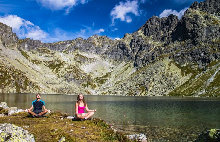 Yoga session at the shore of the deepest lake in the High Tatras while hiking... to be honest we don´t really know how to practise it, but we thought a picture like this would be cool.
