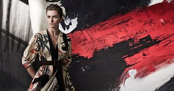 Paint the town red with this one-of-a-kind, hand-painted, billboard coat of modern abstraction, splashed with scribbles and sequins.