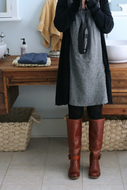 Grey dress, black cardi and tights, brown boots.  Love!