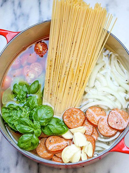 20 One-Pot Pasta Recipes That Will Change Dinner Forever | BASIL, SAUSAGE & TOMATOES | The spaghetti will soak up all that glorious garlic and andouille flavor while it cooks in the pot. Get the recipe HERE.