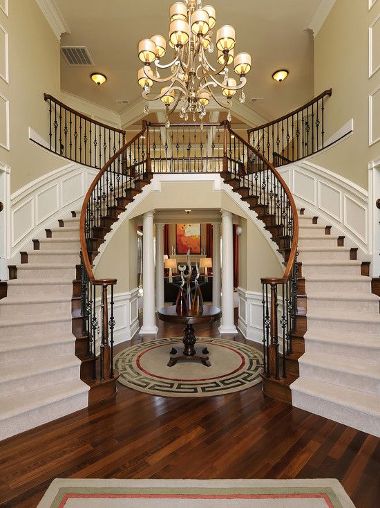 Corbett Roma Chandelier Above A Dual Staircase Hardwood