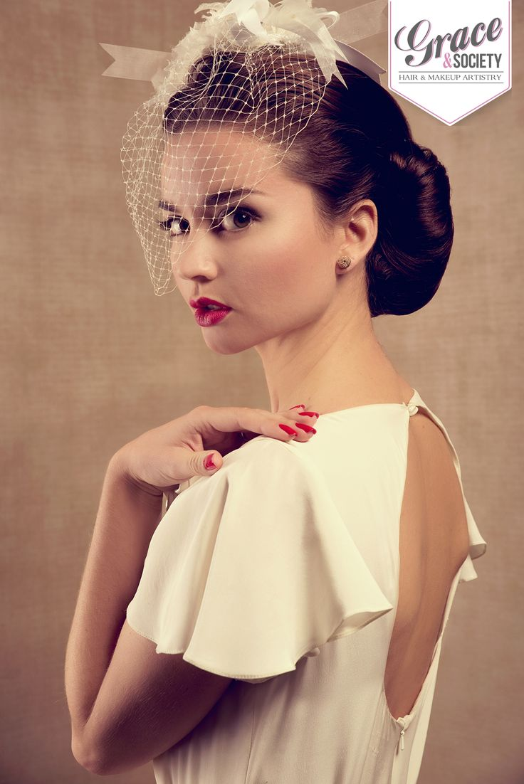 My version of 1940's victory roll, always a classic look for any bride.  Keep eye makeup simple, using a soft grey socket line and strong black eyeliner. To complete the look, dramatic lips using illamasuqa lip colour in Box. #vintageinspiredwedding