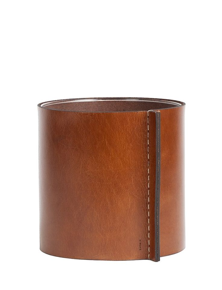 Each vase in the Hold Me Tight series is formed and sewn by hand from Swedish vegetable tanned leather