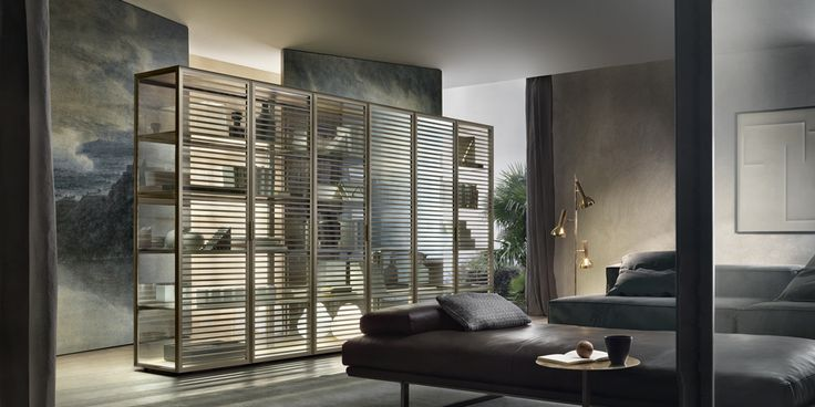 Alambra with structure in palladio aluminum; doors, side and back panels in rifl ettente chiaro glass, top in mat lacquered palladio glass, shelves in transparent gray glass.