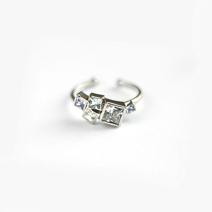 Silver  cluster ring with cubic zirkonia by Res Depot